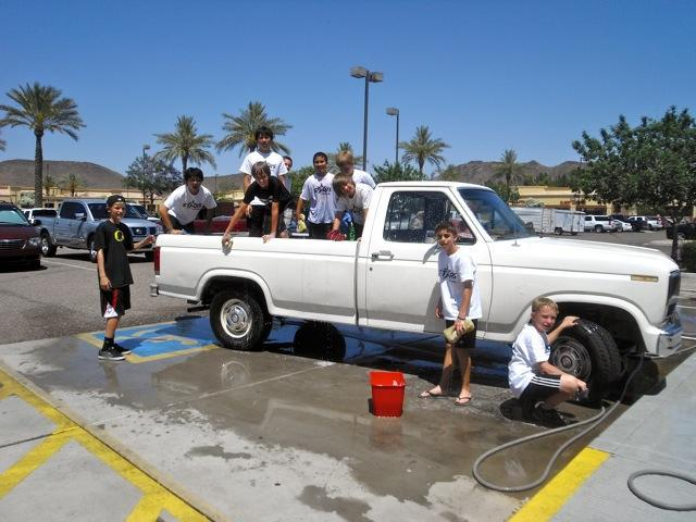 Boys wash our last customer, Tony Burgarello's truck